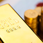 gold bars or sovereign coins featured